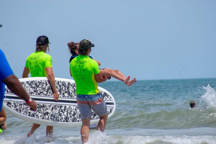 Maria Antonia NC 18 green leader carrying girl into water 198.jpg