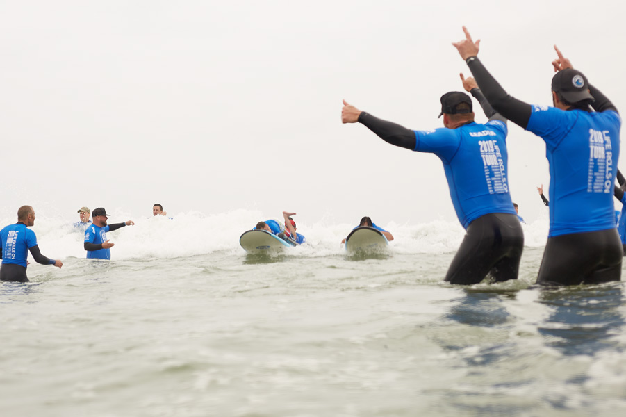 two blue surfers coming in AGI SM 19 158.jpg