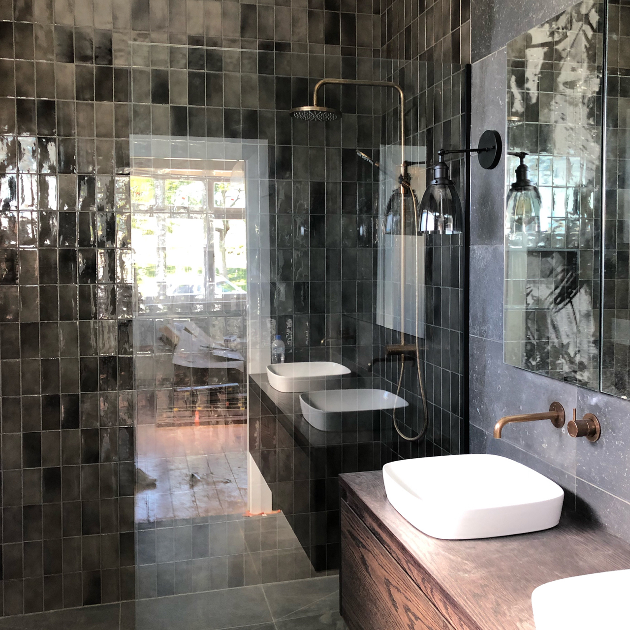 Beautiful dark tiles from Artedomus  https://www.artedomus.co.nz/   Tapware and vanity from Plumbline  https://www.plumbline.co.nz/