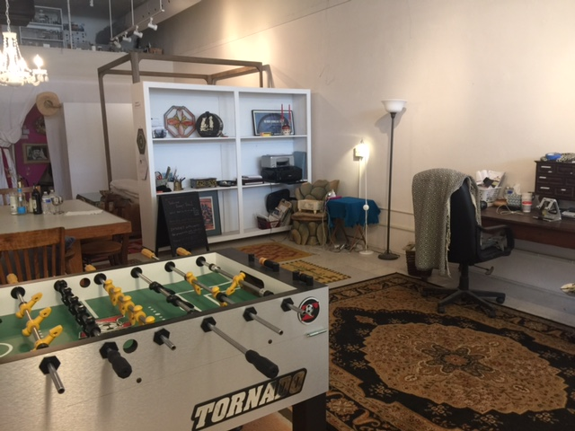 Office with 3 work desks/foosball table (walls are on wheels)