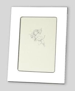 """8x10 Nickel Plate Frame   High quality nickelplated photo frame. Plain design has a large border for engraving. Nickelplate stays shiny and doesn't tarnish. Overall size is 9¾"""" x 11¾"""". Price of $43.00 does not include engraving."""