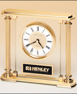 Glass and Brass Clock   Glass and brass clock with diamond-spun dial and 3 hand movement. Lifetime guaranteed movement. Price of $191.00 does not include engraving. Engraving is the greater of $24 or 30¢ per character. Overall size is 6-5/8 x 7¼ x 1¾.  Lifetime guaranteed movement