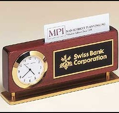 Clock and Business Card Holder   Combination clock and business card holder in rosewood and gold. Price of $79.00 includes 3 lines of engraving. Overall size is 2 3/8″ x 5 7/8″.  Lifetime guaranteed movement.