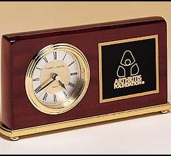 Rectangle Clock   Rosewood piano finish with brass base. Diamond spun dial and 3 hand movement that is guaranteed for life. Price of $86.00 does not include engraving. Engraving is the greater of $24 or 30¢ per character. Overall size is 4″ x 7 5/8″.