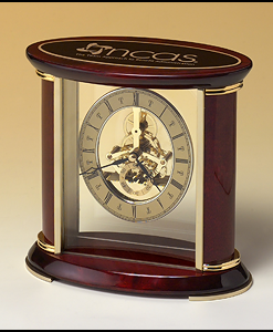 Skeleton Clock   Skeleton Clock with sub-second dial, brass finished movement and rosewood piano-finish accents. Price of $199.00 includes 3 lines of engraving. Overall size is 7″ x 9″ x 3″.  Lifetime guaranteed movement.