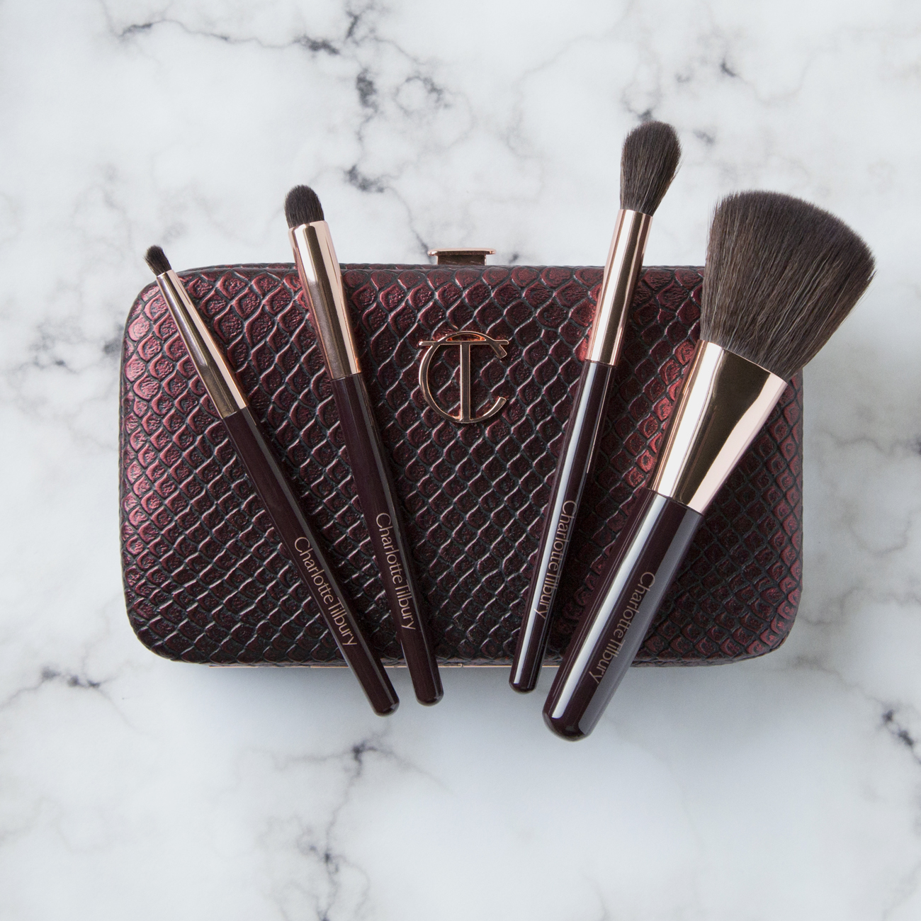 Charlotte Tilbury Magical Mini Brush Set   I've heard Charlotte's brushes are amazing and I really wanted to try them out but they're pretty darn expensive, $26-85 each. Enter Charlotte's Magical Mini Brush Set. The price was right and I liked the style of brushes so I went for it (this was another of my non-sale item purchases). In particular I liked the look of the two smaller brushes since I don't have that many options in smaller eye brush options and I'm so glad I got this because these are exactly what I needed! The travel case this came with makes it a great option for on-the-go touchups without having to dig around for brushes in your bag. I'm very happy wit these brushed and have used them every day I've worn makeup since I bought them. This brush set cost $65 which is way more easy to take compared to the $320 for her   Complete Brush Set   which contains eight full size brushes.
