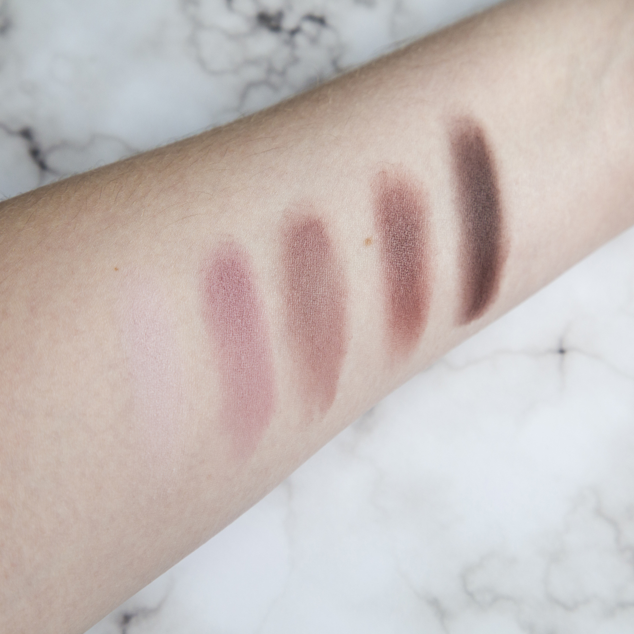 Dose of Colors Marvelous MauvesL-R; Fluffy (which you can barely see on my skin tone), Rosy, Wishy Washy, Spaced Out, and Wine Stain