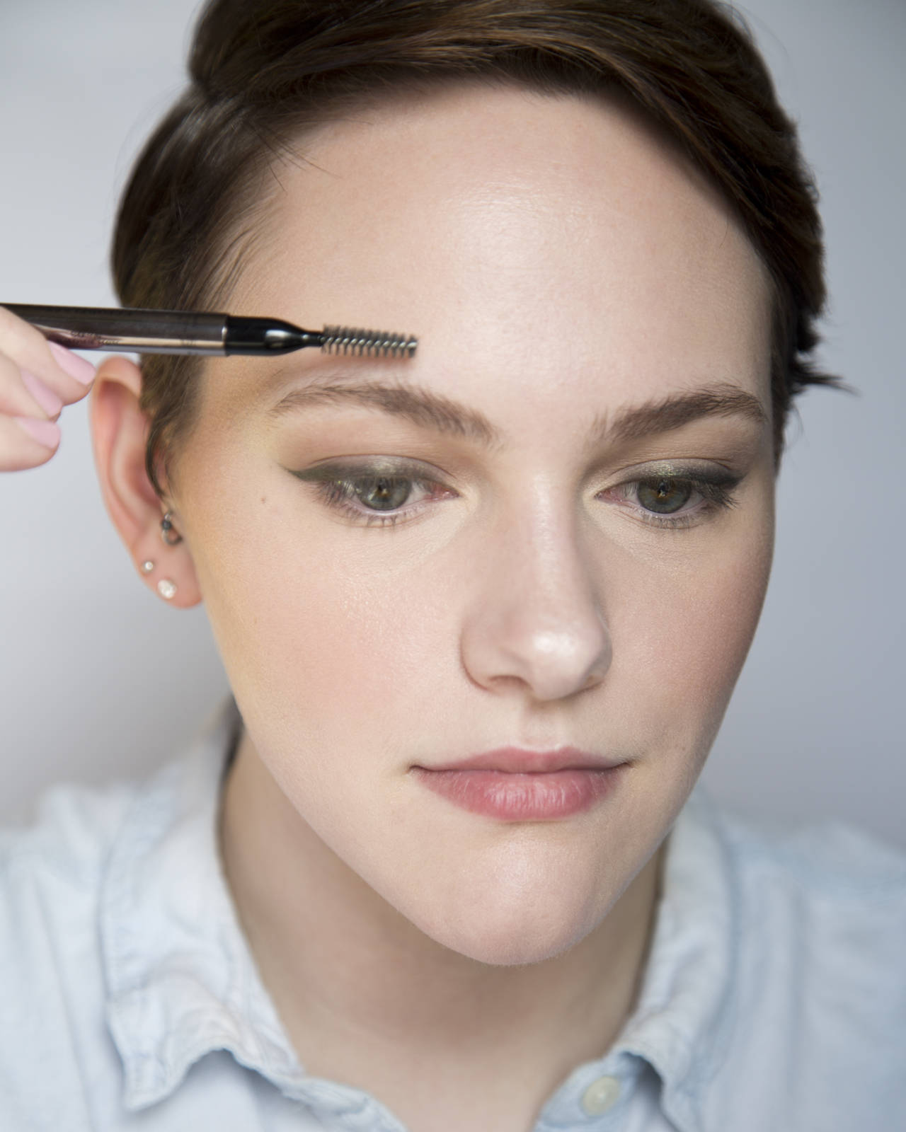 I looked in the mirror after that and knew I had to do brows next to frame the face. Here I am just brushing out my brows with the spoolie end of my Burberry brow pencil.