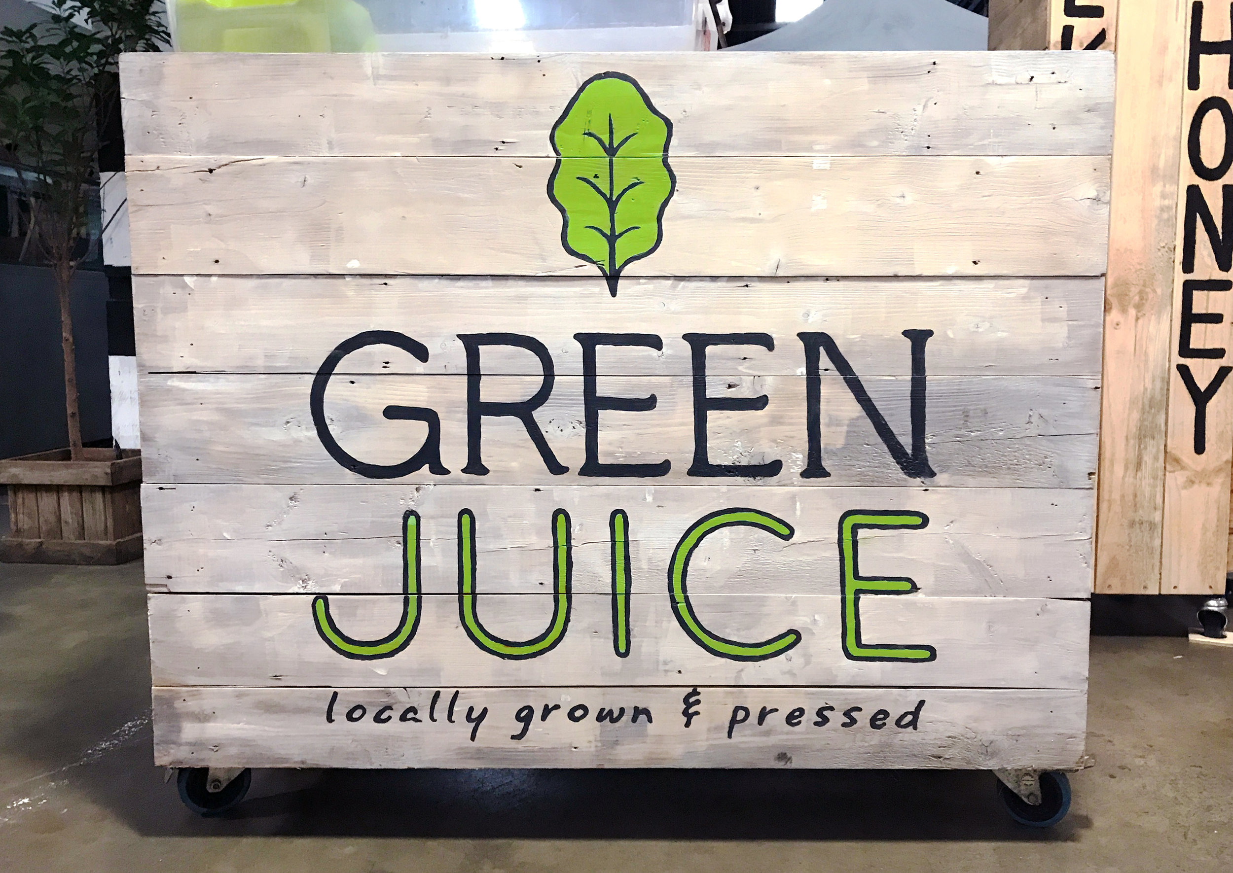 Hand-painted on one of the Green Juice market stall facades. The logo was designed to work well with the rustic feel, so the project & paint method worked perfectly. ^_^