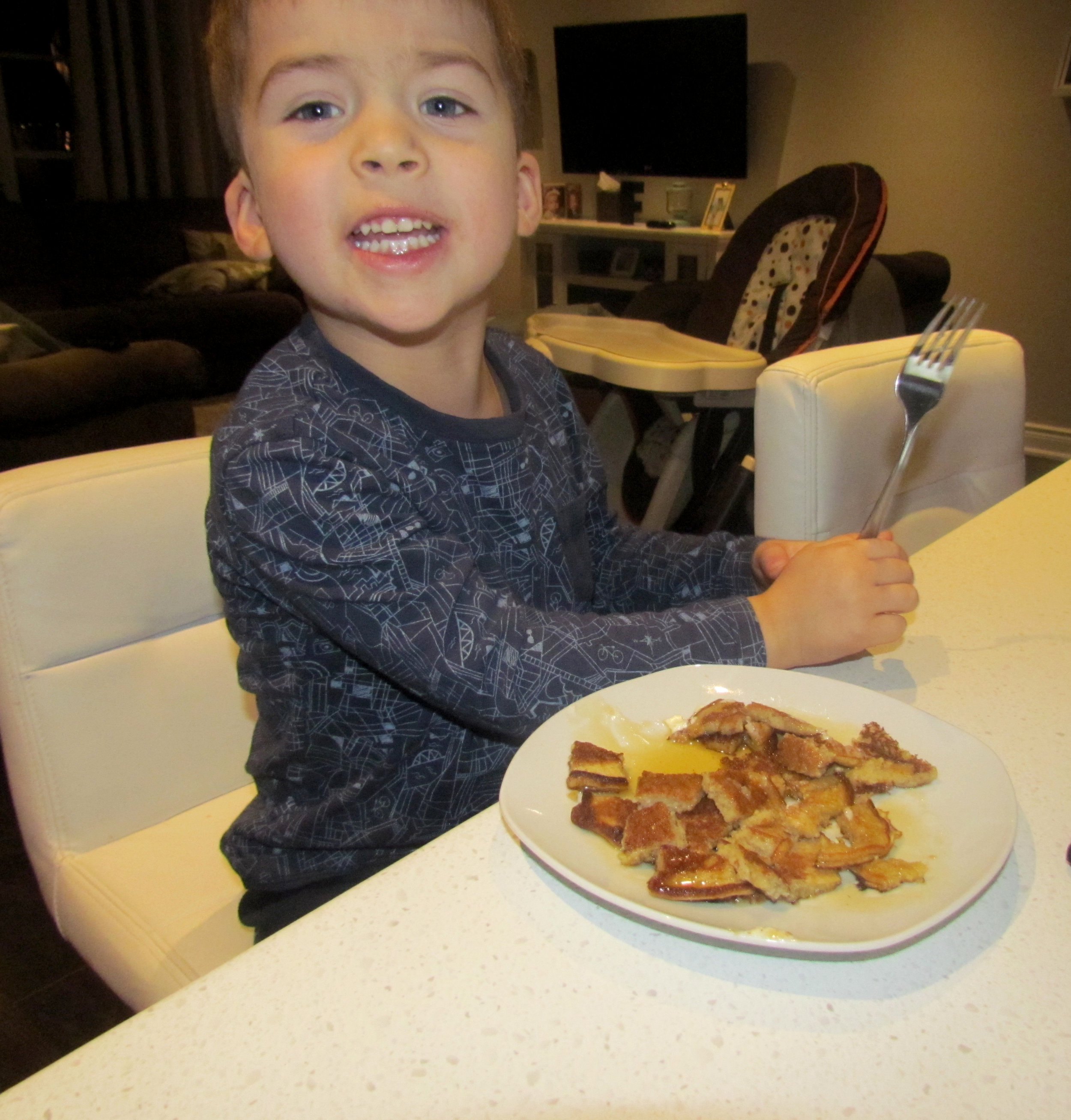 """This is Fletcher's """"cheeeese"""" face. You'll see it a lot. He can't eat cheese, but he can say it."""
