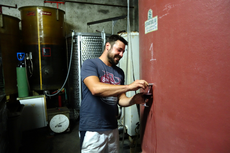 Romain, the vigneron, pouring right from the tank! Photo credit:  Not Drinking Poison in Paris  wine blog