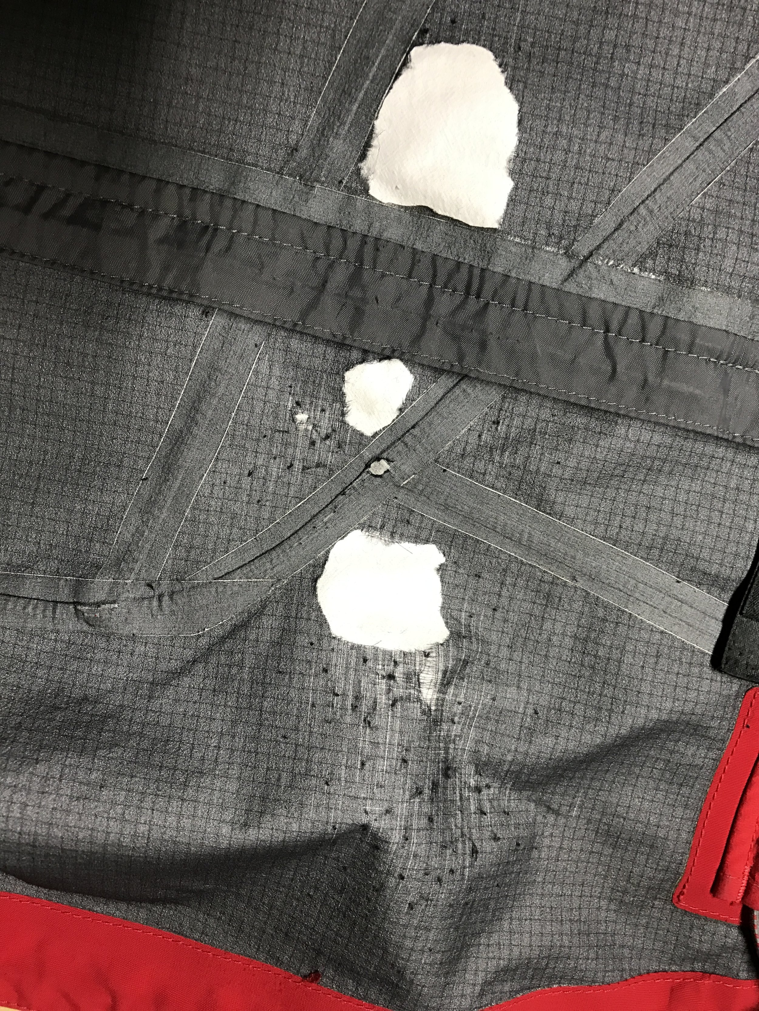 The protective tricot liner has worn through on this ski patrol uniform after full time use with a pack.