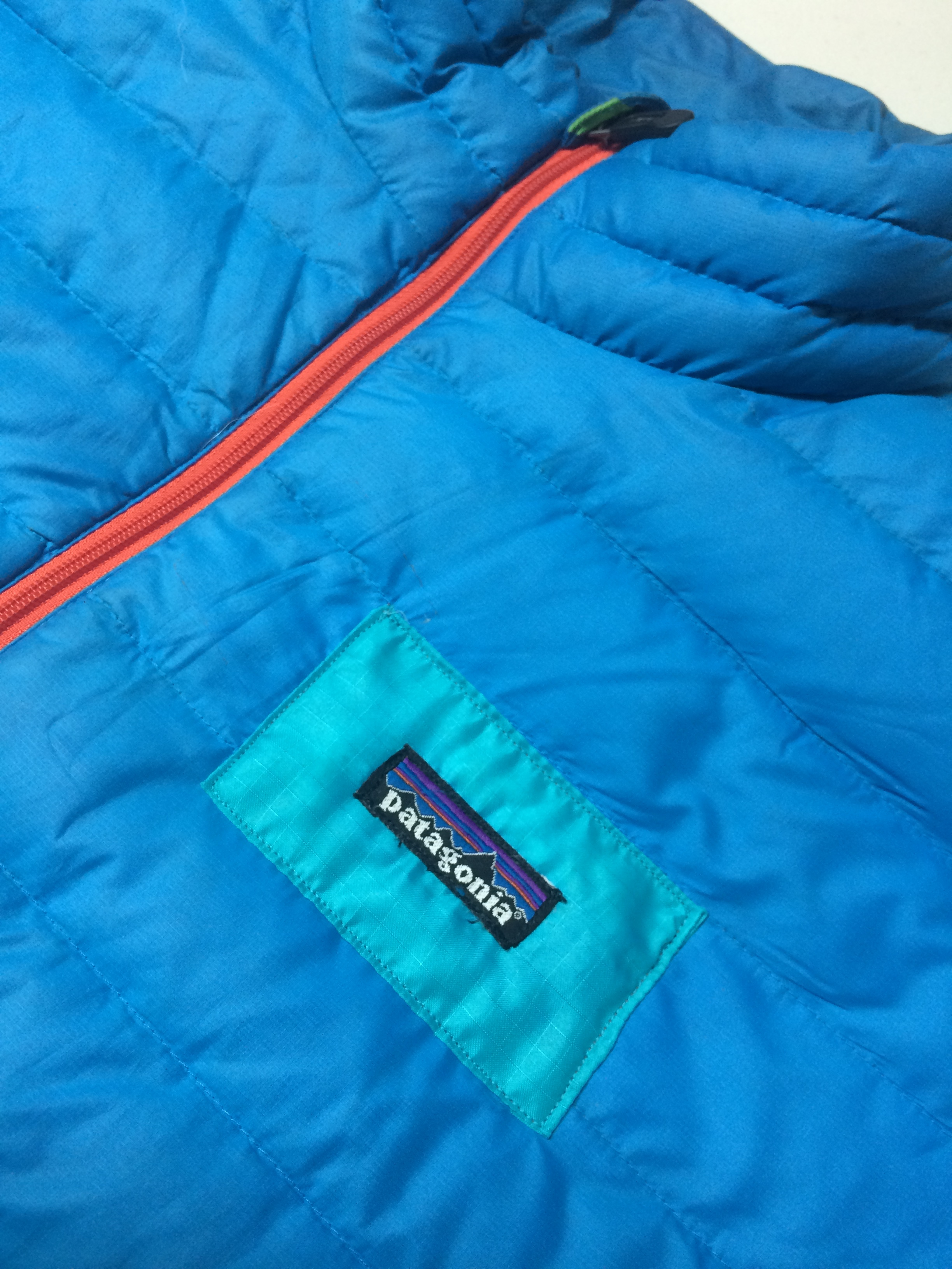 Simple patch on a puffy jacket. Not quite a perfect color match, but lots of character here.