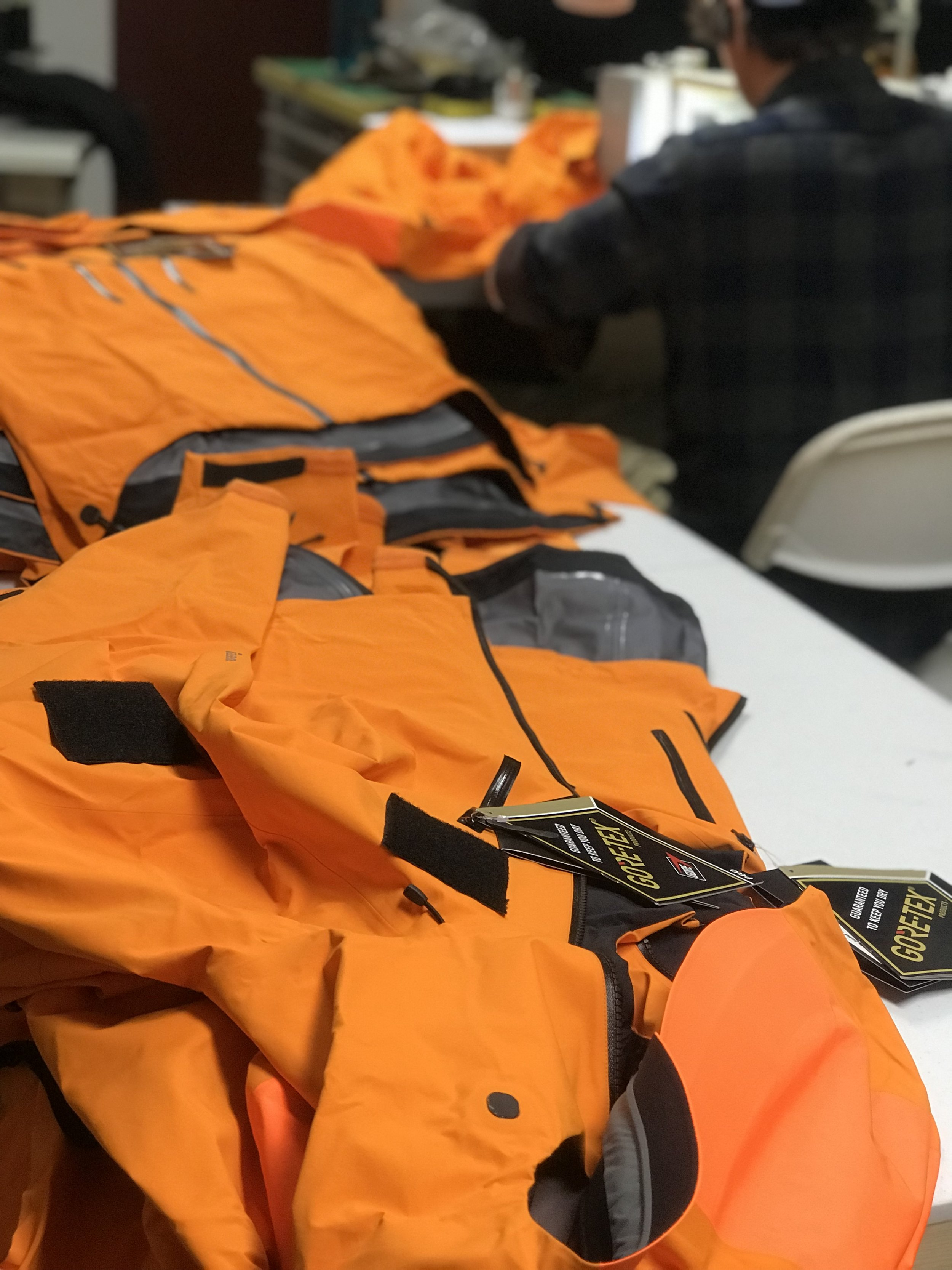 Applying Velcro® patches to Gore-Tex® jackets for Denali NPS Climbing Rangers. Fully seam taped.