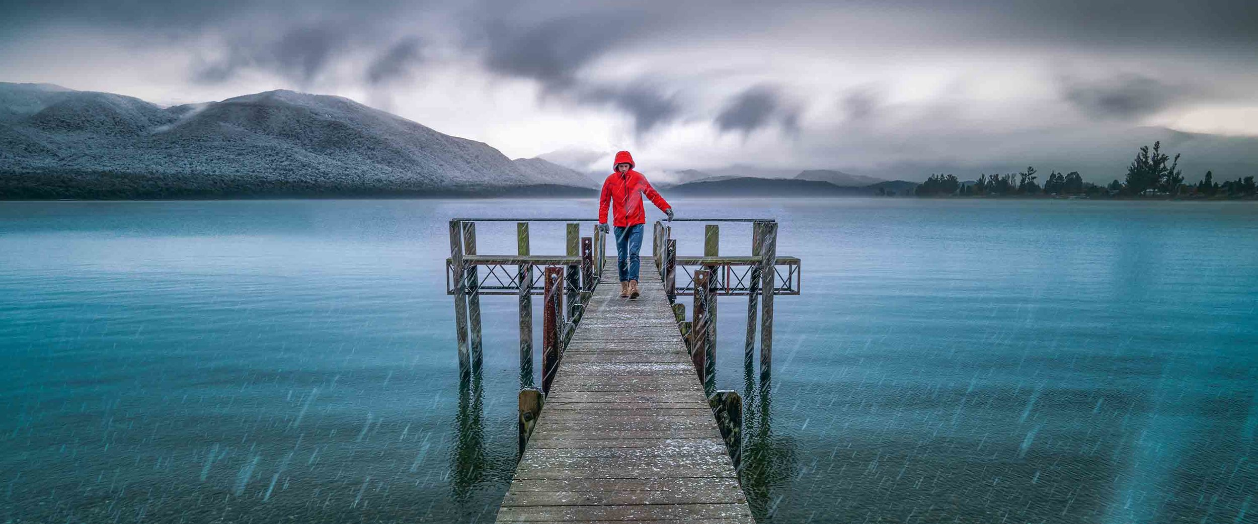 Te Anau, New Zealand,   Yes this is a selfie. This photo i love, it was May in NZ and this morning brought the first snowfall of the winter. I was travelling from Milford Sound back to Queenstown and i was caught in Te Anua for a day as the roads were too hazardous. It turned out being one of the best days of the trip, i met a local photographer who was super cool, i ate some delicious food in the Te Anau restaurants while taking in these amazing views.