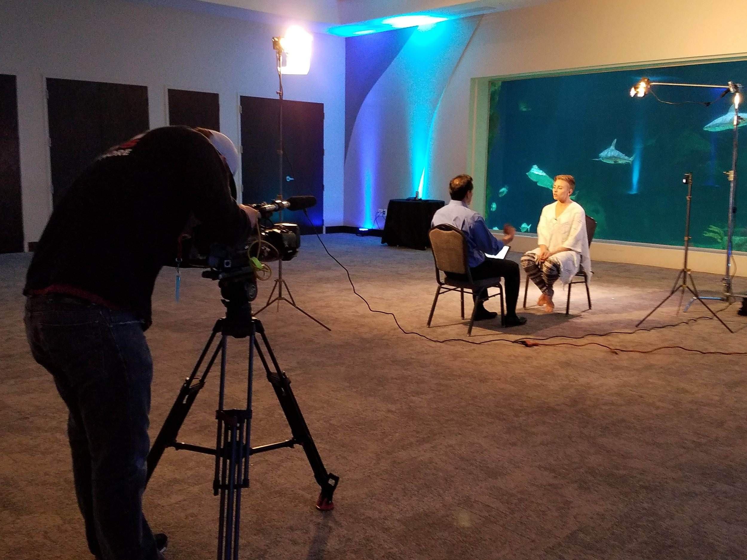 KUTV's Dan Rascon interviewing yoga instructor Amanda Jones at Living Planet Aquarium.