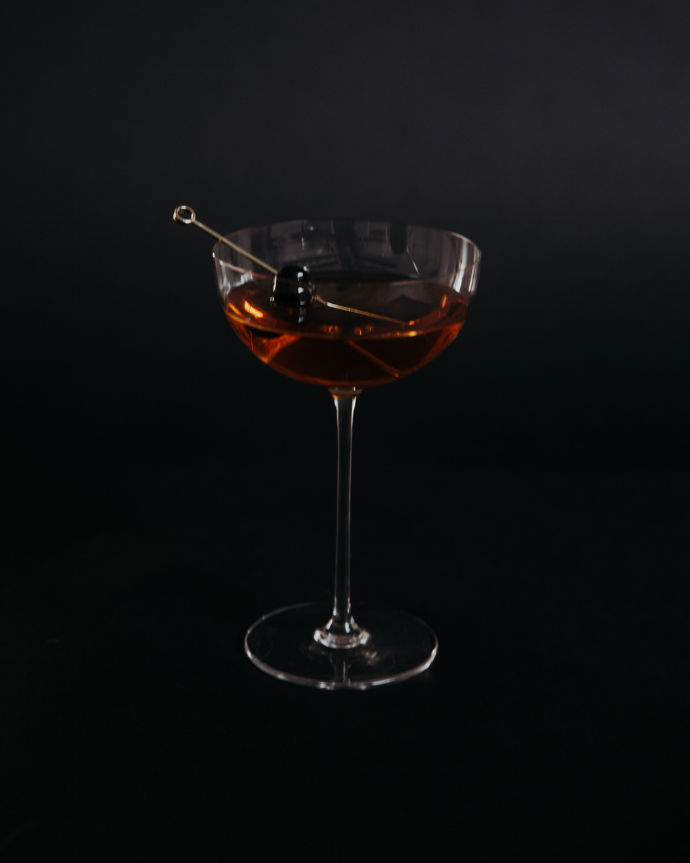 Coffee + Cherry - Dear Darla - 1 ½ oz Dickel rye½ oz Bual Madeira½ oz Amaro Montenegro3 dashes Honest John Coffee + Cherry BittersStir all ingredients in a stirring glass with ice. Strain with a julep strainer into a coupe glass. Garnish with a Luxardo cherry.
