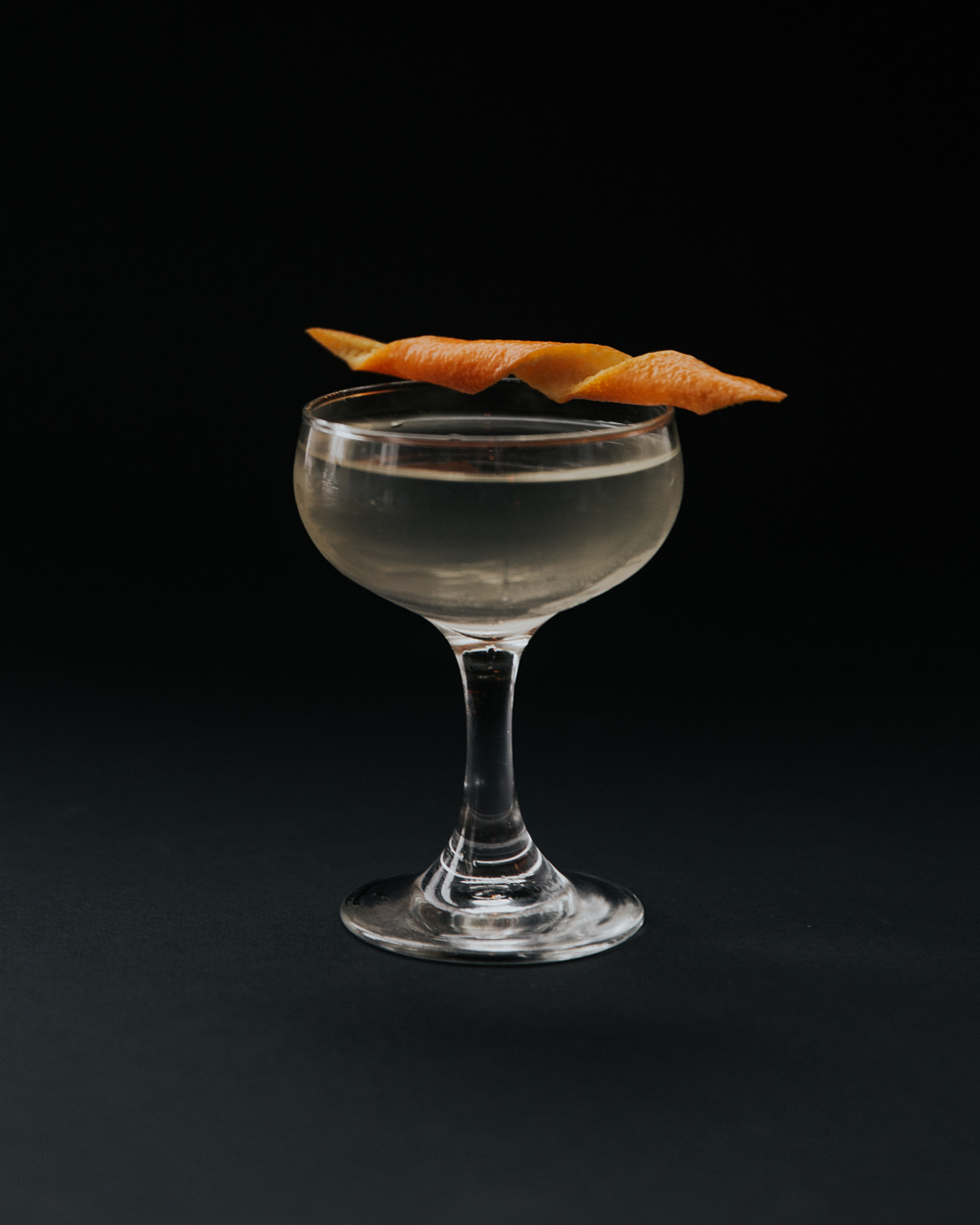 Lemongrass Cardamom - Dry Me a River - 1.5oz Bozal Ensemble Mezcal0.75oz Lillet Blanc0.25oz Dry Curacao3 Dashes Honest John Lemongrass Cardamom BittersCombine all other ingredients in mixing glass. Stir until well chilled. Strain into a coupe glass. Garnish with an orange twist.