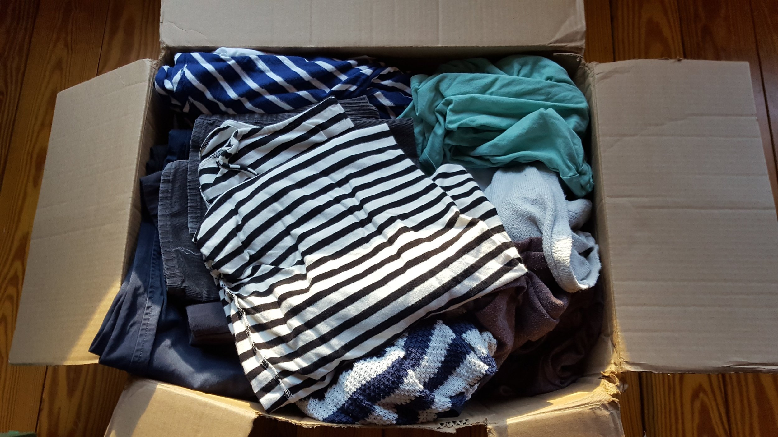 Clothes arrive ready for their fourth round of wear!