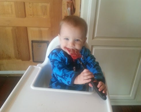 My son helping make his first birthday cake