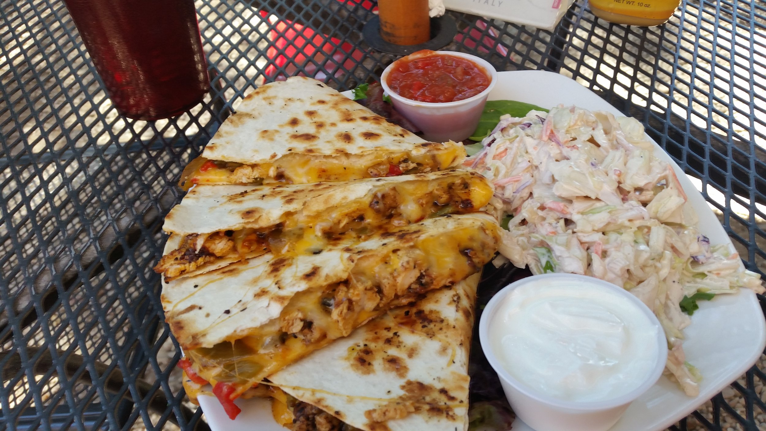 Chicken, green chile and cheese quesadilla with coleslaw at The Hollar in beautiful downtown Madrid