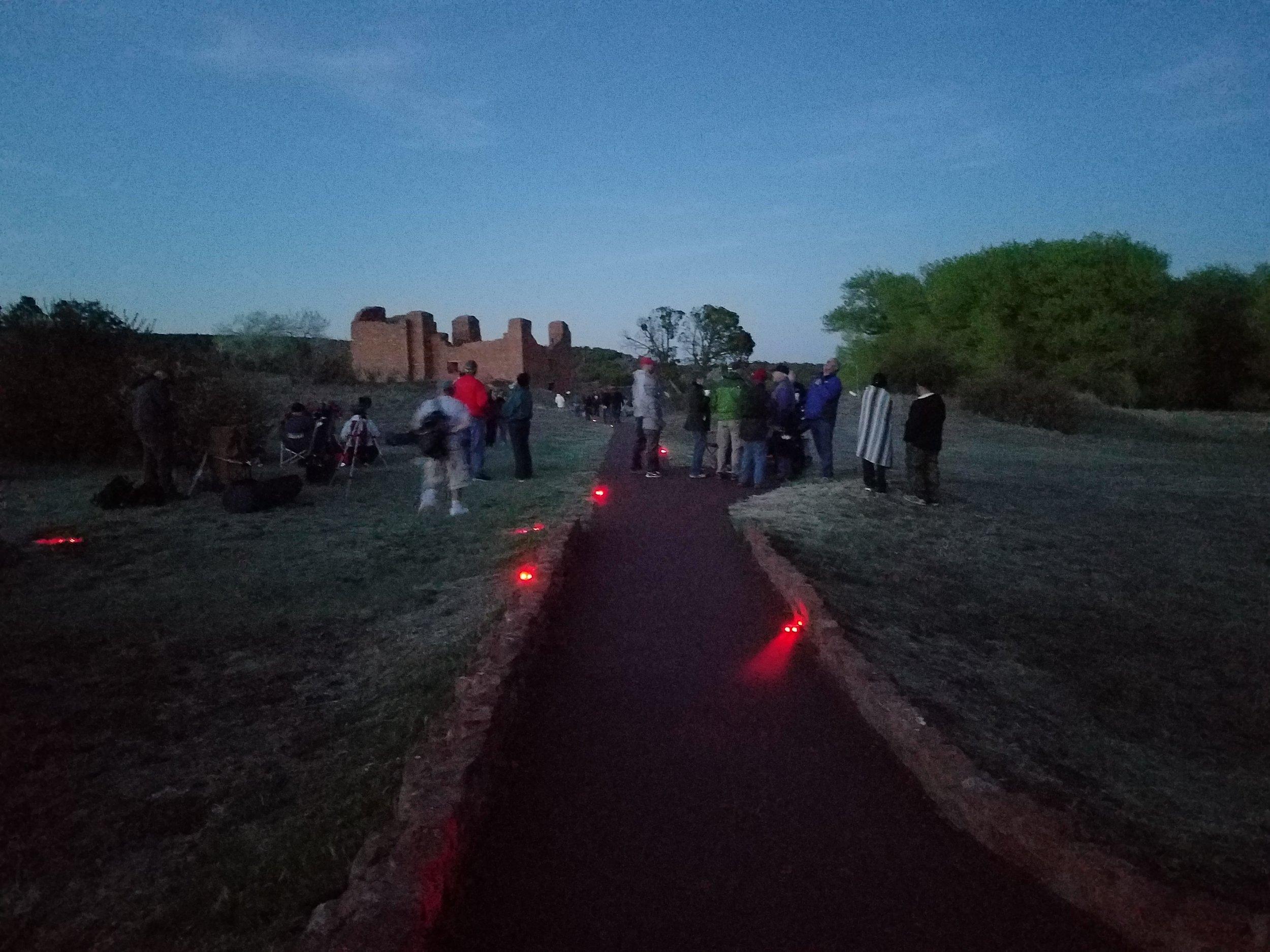 Downward poiting red path lighting at Quarai