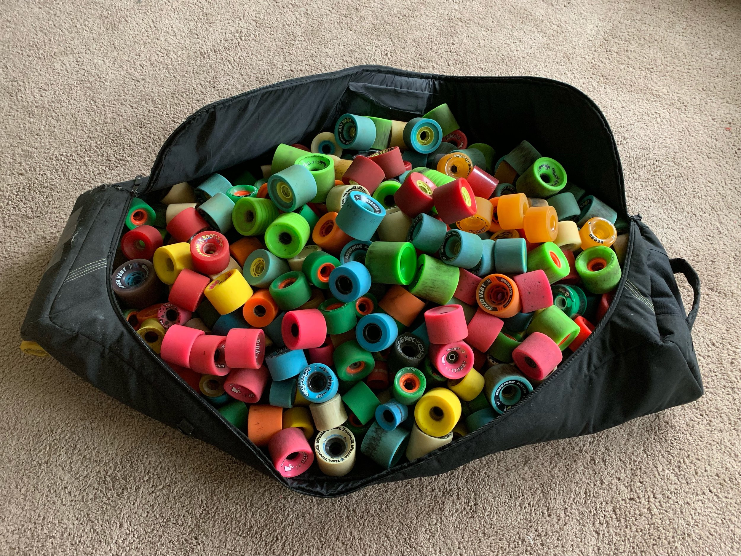 100+ sets of longboard wheels from the stash.