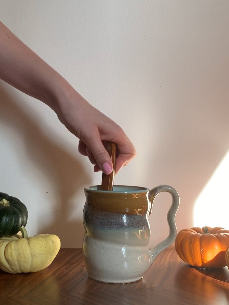 stir+together+coffee+and+milk.jpg