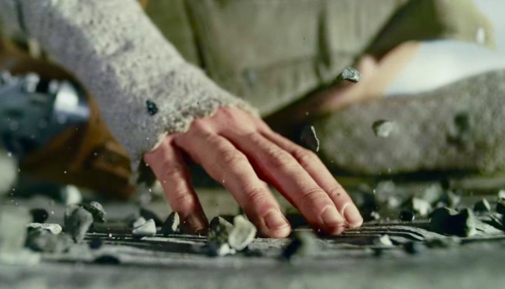 Rey makes rocks float while meditating on the Force