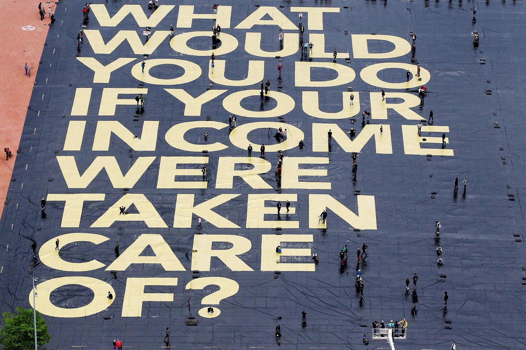 61400969-basic-income-poster-dpa.jpg