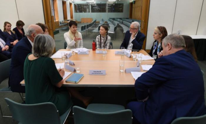 "UK politicians meet Greta Thunberg, with an  ""empty chair""  for Teresa May"