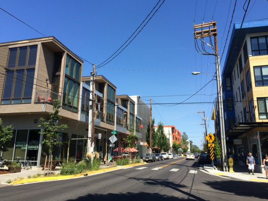 Gentle density, where residential and commercial share the same street and the block is filled in. Photo: The Daily Scot.