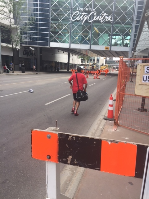 Edmonton is a great place to get in some unplanned running – which this guy is doing in order to walk through the downtown. Clearly he's feeling the Vision Zero love. Photo: Tim Querengesser