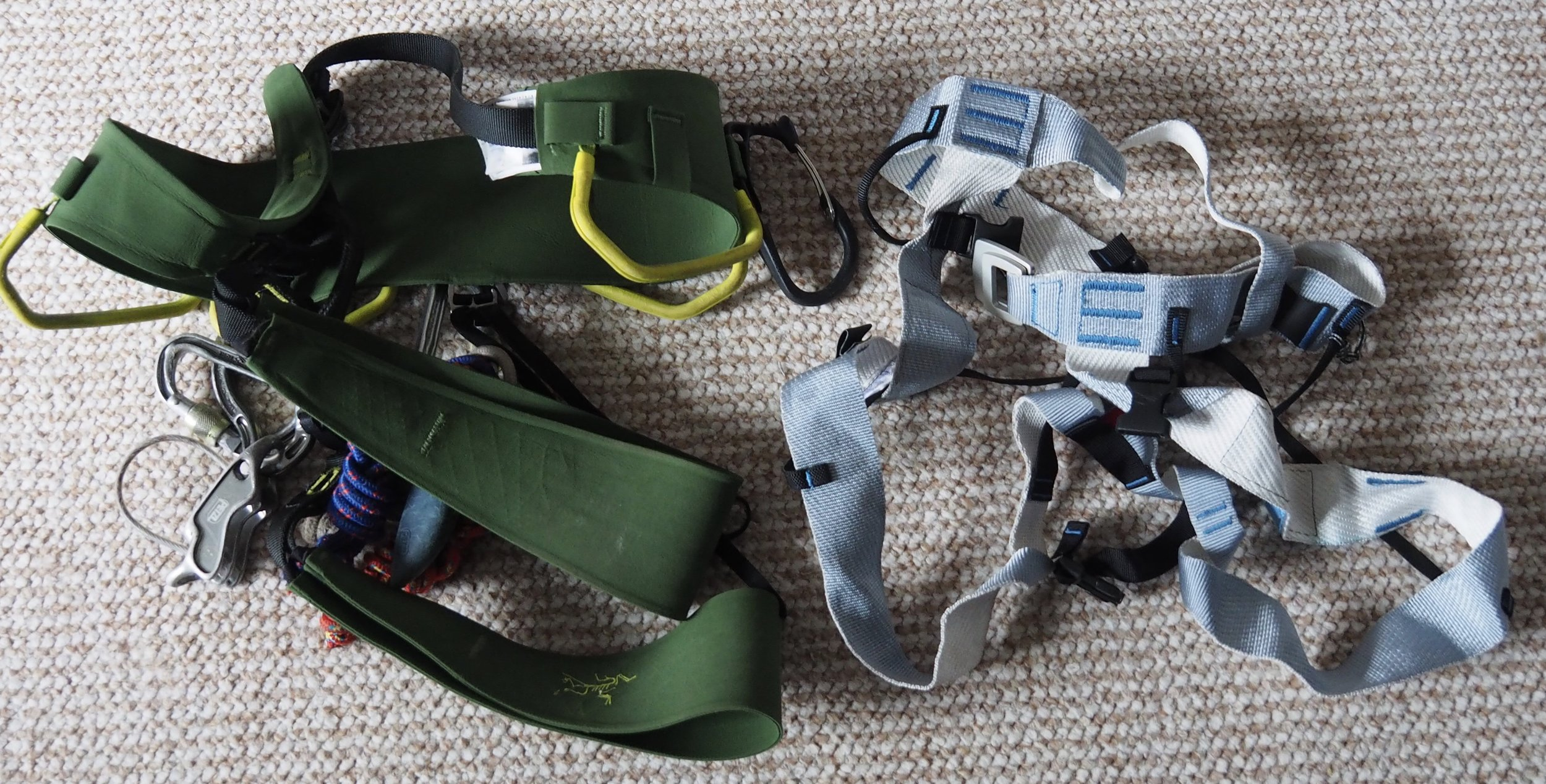Traditional Harness and light weight alpine harness, note the Ice axe clipper on the green harness, really useful feature.