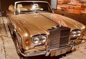 1968 Rolls Royce Silver Shadow drop top. If you show up to high school in one of these, trust me - people notice.