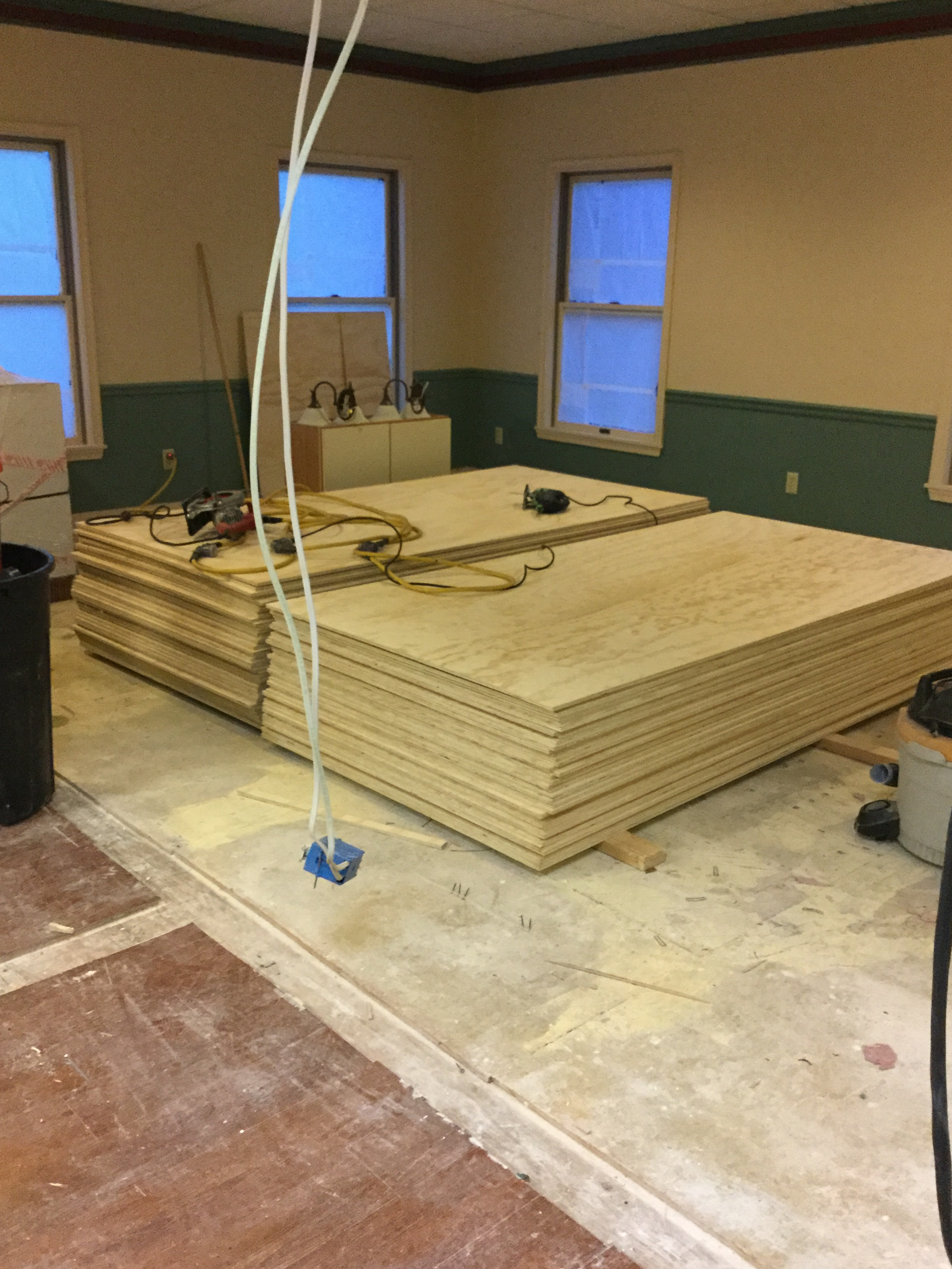 Delivery! Plywood for the base under the epoxy floor. 90 sheets were cut to fit and screwed in with 12,000 screws.