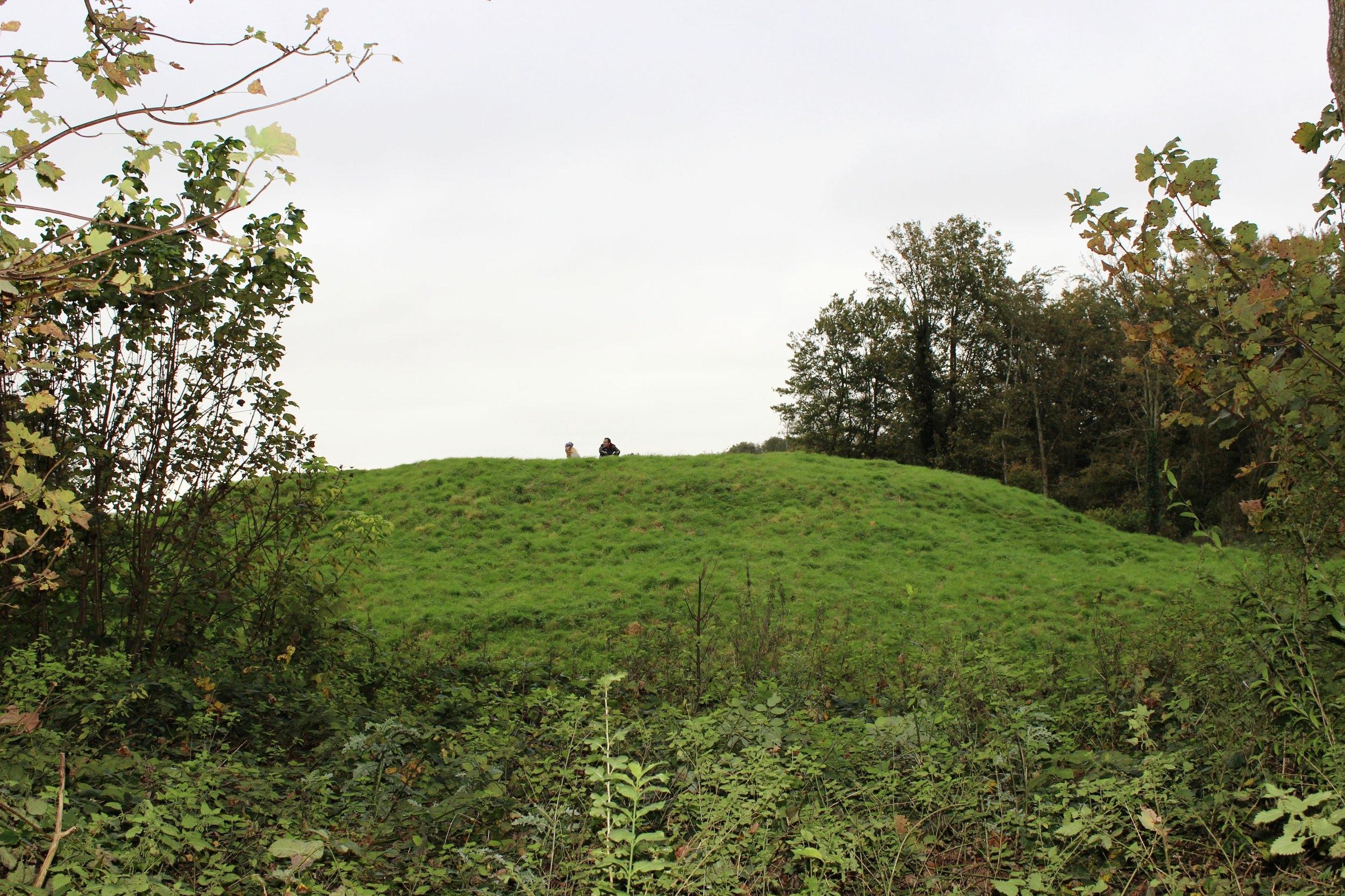 Couple Sitting on Mound