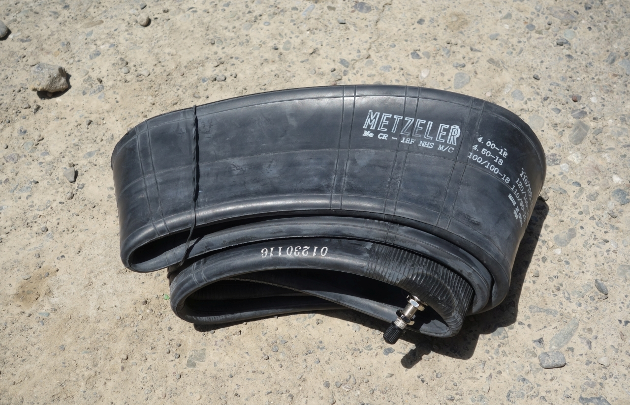 A regular spare tube. In case of a flat tire it is convenient to fit the spare one and repair the fitted heavy-duty-tube later.