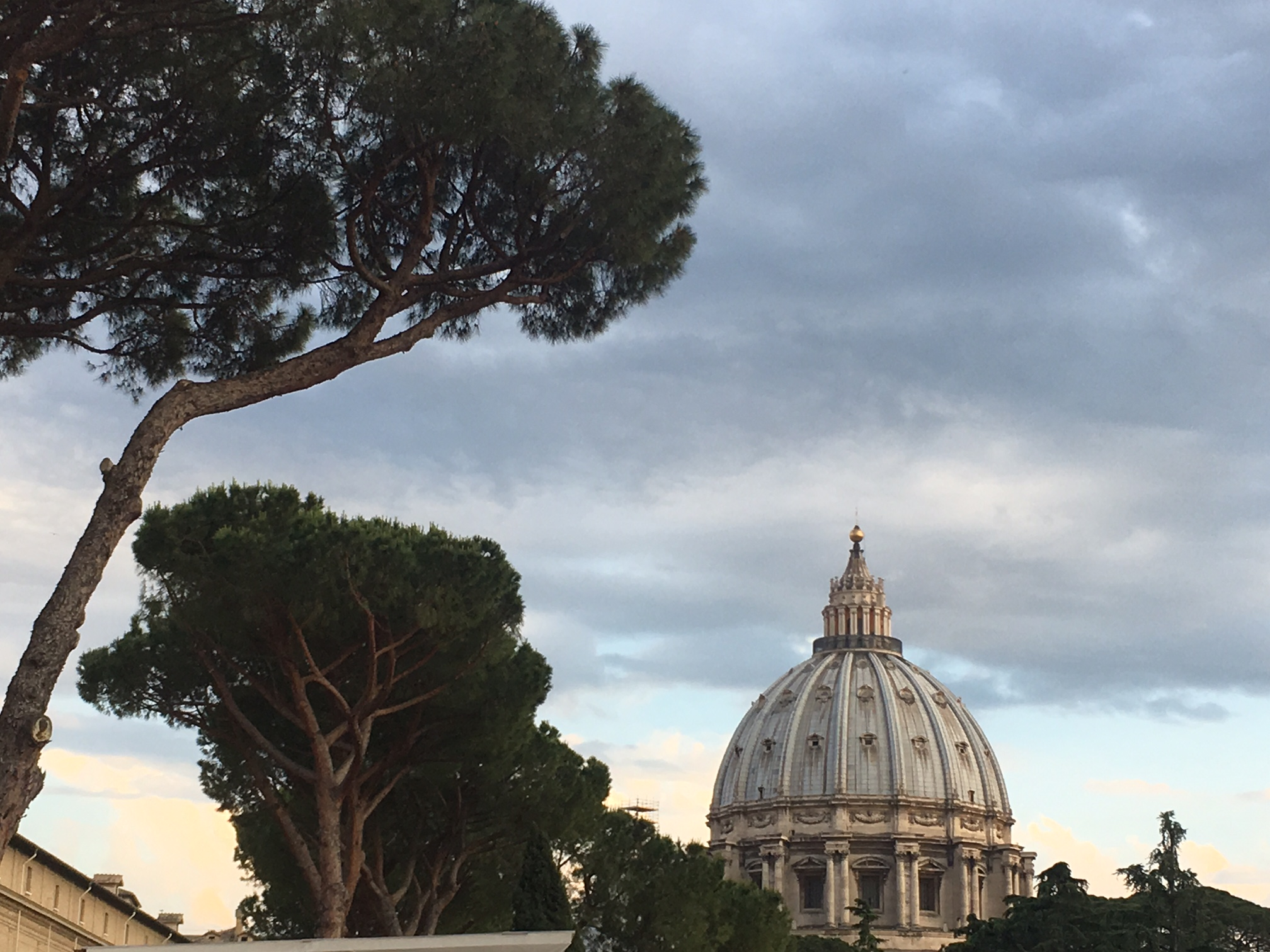 Sunset over Saint Peter's Basilica from the Vatican museum window