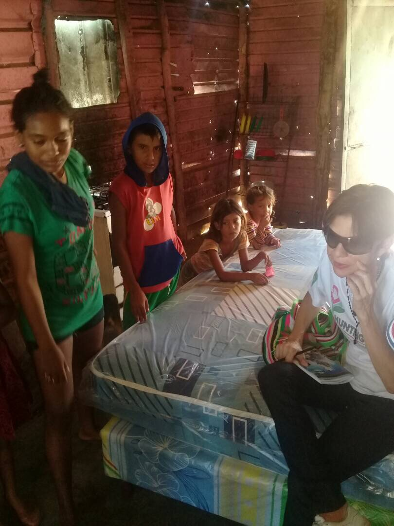Zulay from Fundacion Zulia delivering mattresses and other forms of aid Factor-H provided for the patients in Barranquitas