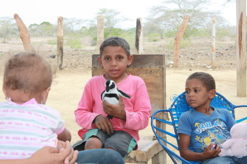 The moment when project Abrazos was born. Olver, then five, and Eduardo, with their first staffed animals.