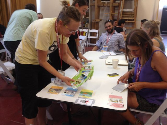 Change Media's artistic director, Jen Lyons-Reid, tests the game with participants