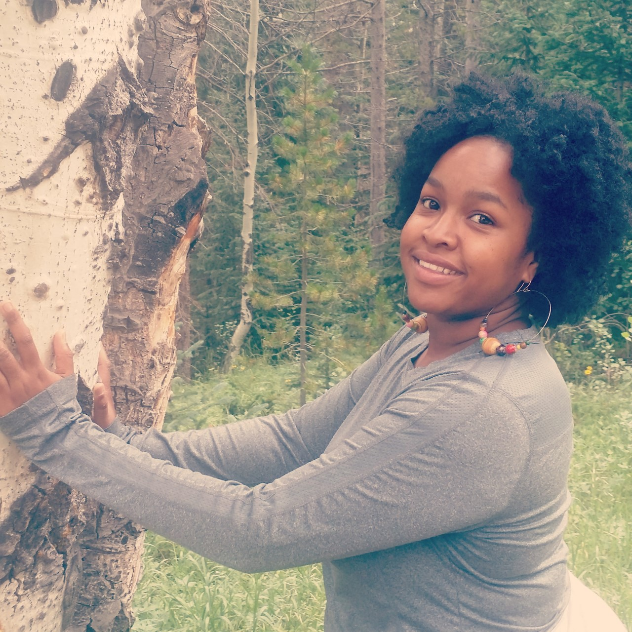 """Aishah Muhammad  is a 2018 Graduate of Satya's 200 hr POC Yoga Teacher Training program. She has been creating one of a kind jewelry since the tender age of 10. At 16 she started a business called """"Spiders and Bumble Bees"""" that produced much local acclaim. She is the co-owner of Jiridon apothecary and teaches community about the medicine that surrounds them in their everyday urban life. Born 10 of 12 artistic siblings, Aishah grew up heavily involved in crafts such as sewing, painting, and creating jewelry. She is fusing her love of stones with a healing practice that will give back to the community. Her goal is to create jewelry that is well beyond the realm of fashion. She hopes that through her jewelry she can also help those who suffer from anxiety, depression and other conditions that negatively affect the heart, mind and spirit   Class Style:  Gentle, nourishing, guided with feminine wisdom, therapeutic and soulful."""