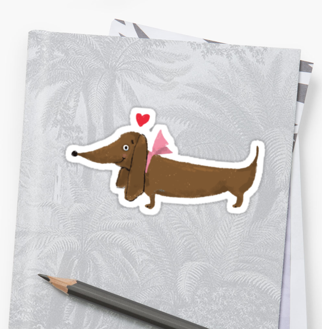 "Need to make a notebook or a laptop even cuter? This ""Puppy Love"" sticker is available on  RedBubble ."