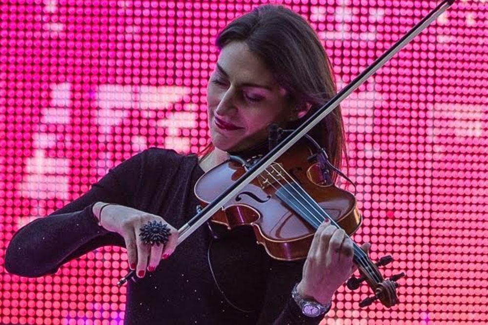 Vanessa Tammetta performs on violin