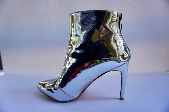 Mirror Mirror - The trendiest of trendy shoes right now are the silver chrome booties! They are a mood on their own. You can flip any look whether dress or jeans and make it Happy Hour ready!