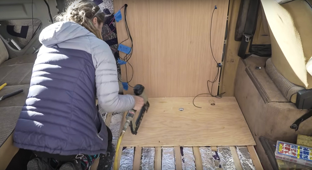 Here we are using a piece of plywood where the cabinet is going to go. That way, we make sure that we have enough visible matching flooring pieces from the Gate we found.