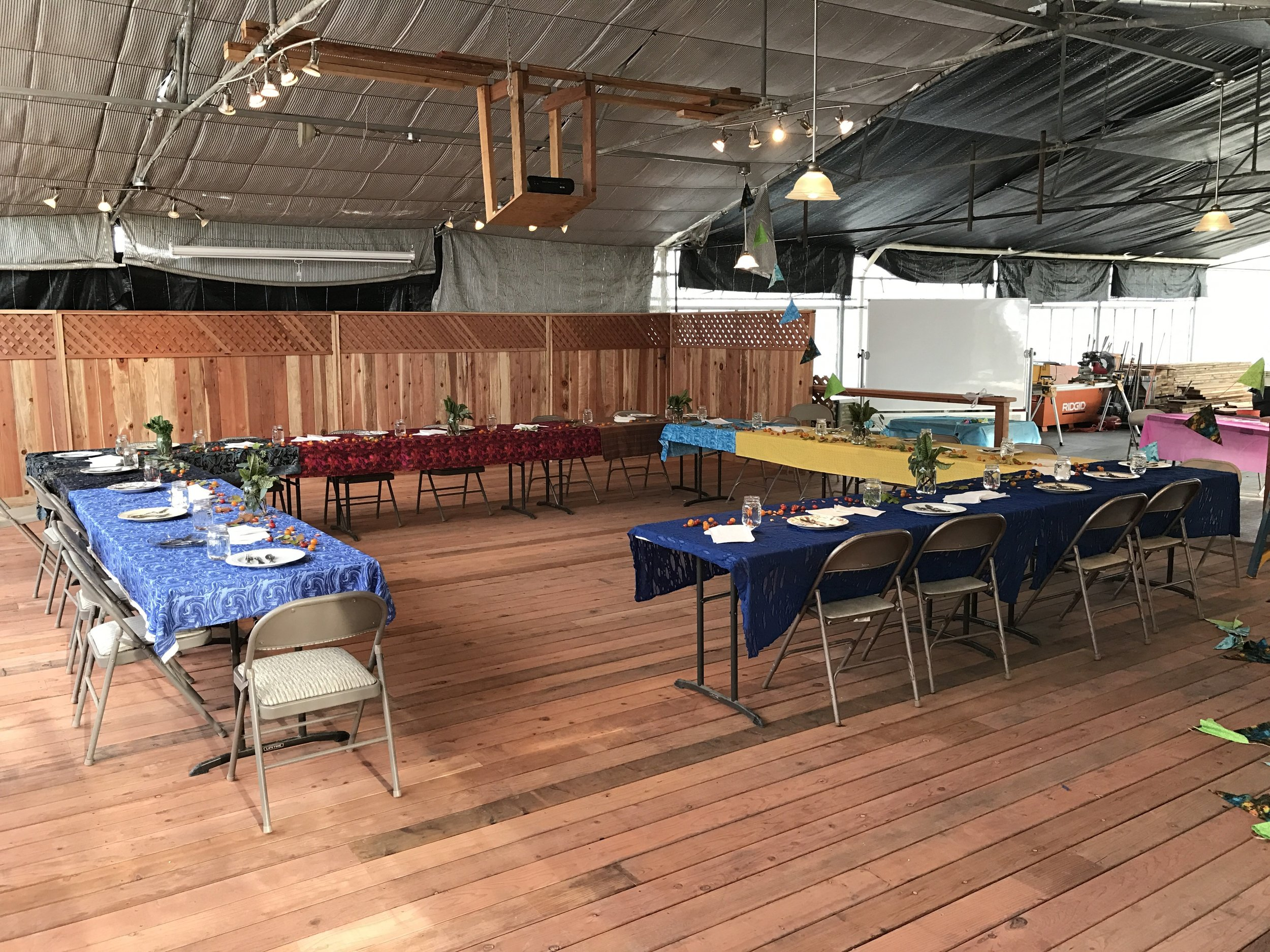 The Ourboros Farms event space is set up for a luncheon in this photo.