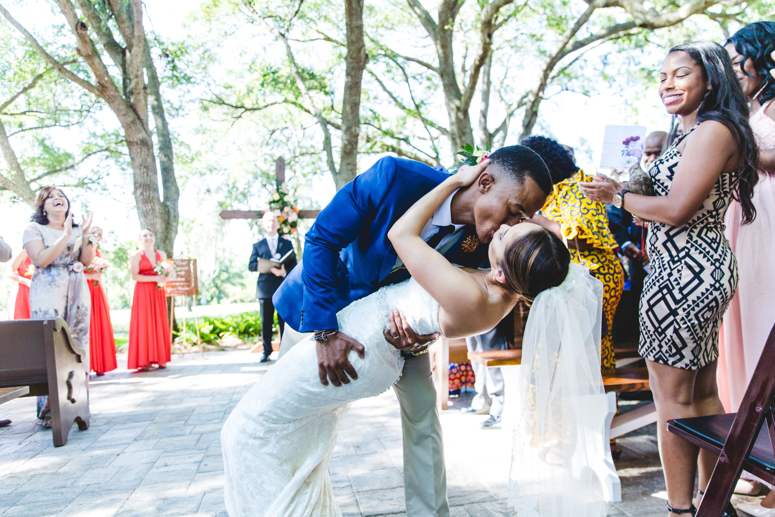 A wedding, engagement, love, newlywed image of a bride in her wedding dress kissing her husband -taken by Miami Wedding Photographer, Javier Edwards of El Roi Photo, in Miami, Florida, for a Miami Wedding