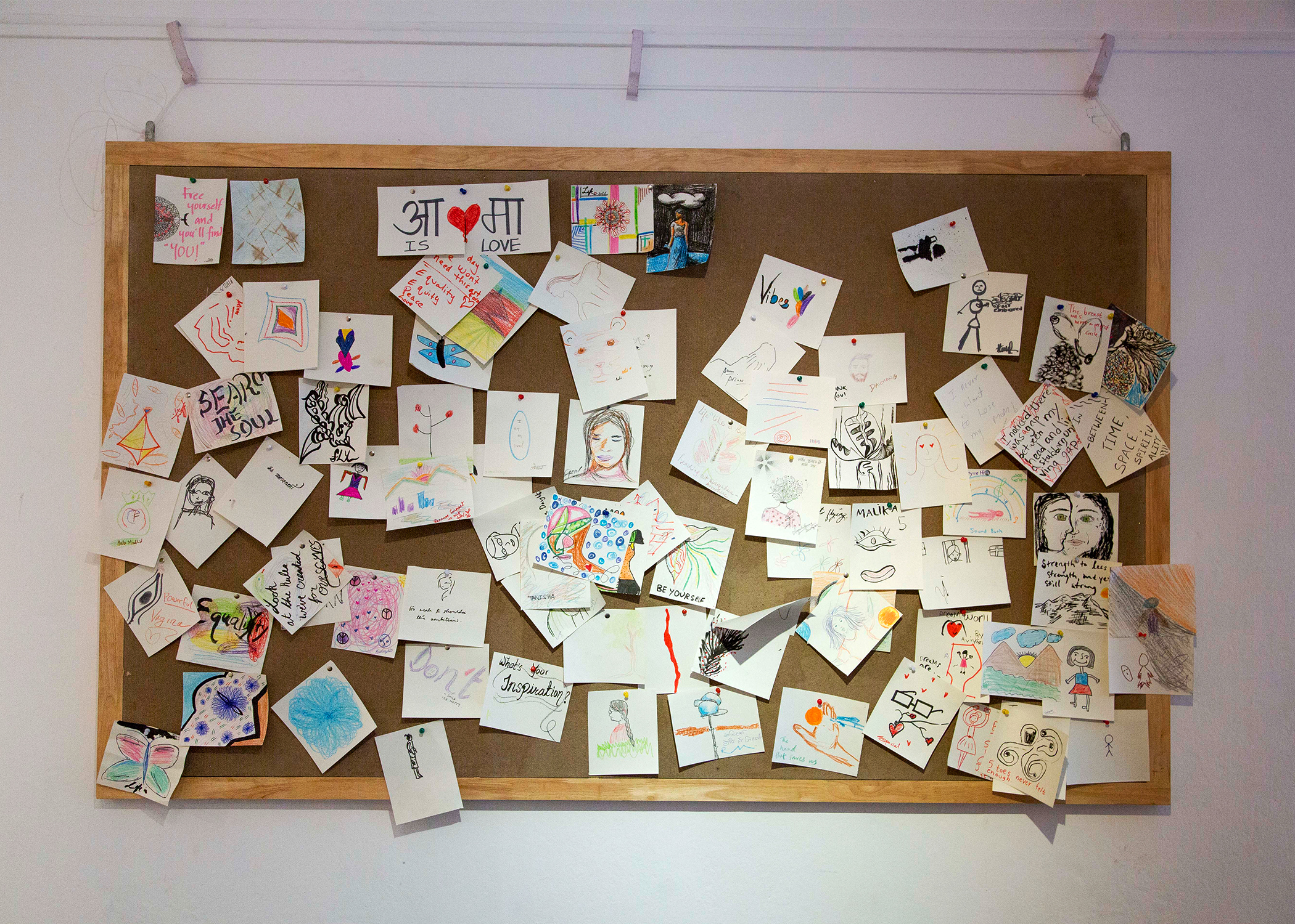 Self-portraits made by visitors to the gallery that accumulated throughout the exhibition.